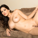Sunny shows her goodies in a sensual strip show on camera.